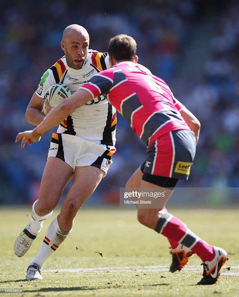 Adrian Purtell (L) of Bradford Bulls runs at Danny McGuire of Leeds Rhinos during the Stobart Super League 'Magic Weekend' match between Bradford Bulls and Leeds Rhinos at the Etihad Stadium on May 27, 2012 in Manchester, England.