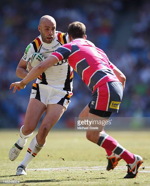 Adrian Purtell of Bradford Bulls runs at Danny McGuire of Leeds Rhinos during the Stobart Super League 'Magic Weekend' match between Bradford Bulls...