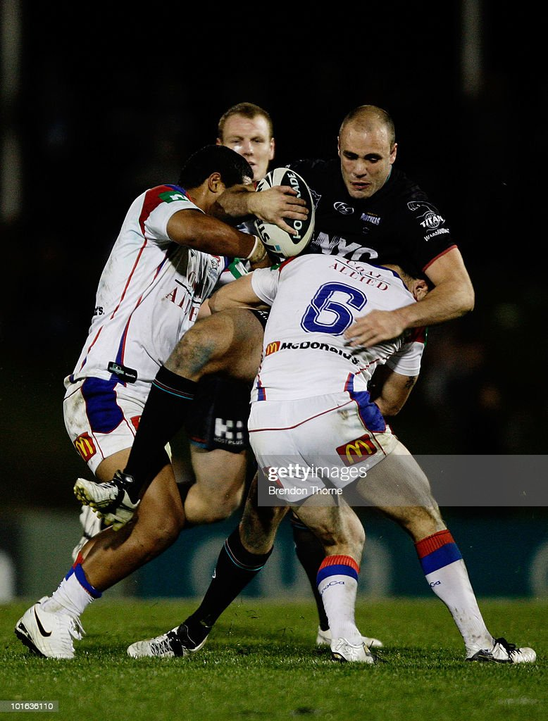 Adrian Purtell of the Panthers is tackled by the Knights defence during the round 13 NRL match between the Penrith Panthers and the Newcastle Knights at CUA Stadium on June 5, 2010 in Sydney, Australia.