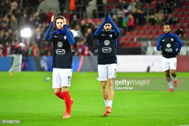 Adrian Rabiot of France and Christophe Jallet of France acknowledge the crowd before the international friendly match between Germany and France at...