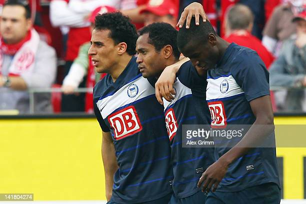 Adrian Ramos of Berlin celebrates his team's third goal with team mates Raffael and Aenis Ben-Hatira during the Bundesliga match between FSV Mainz 05...