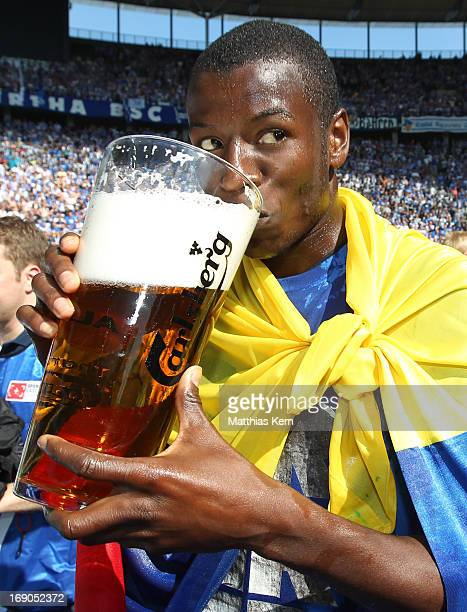 Adrian Ramos of Berlin drinks a beer after winning the championship after the Second Bundesliga match between Hertha BSC Berlin and FC Energie...
