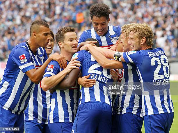 Adrian Ramos of Berlin jubilates with team mates after scoring the sixt goal during the Bundesliga match between Hertha BSC Berlin and Eintracht...