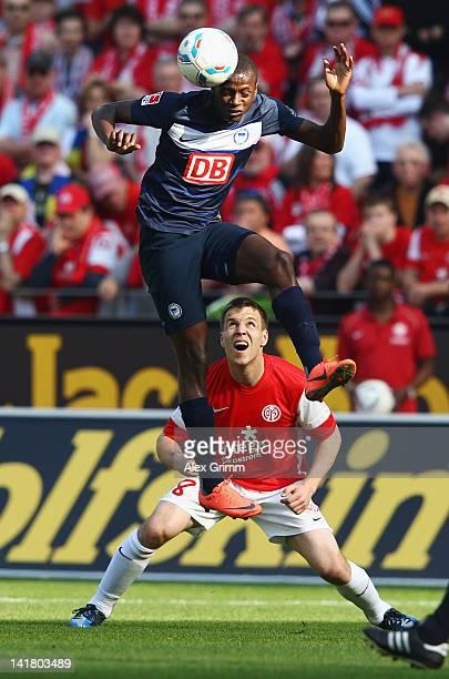 Adrian Ramos of Berlin jumps for a header in front of Radoslav Zabavnik of Mainz during the Bundesliga match between FSV Mainz 05 and Hertha BSC...