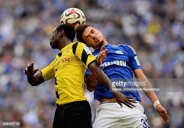 Adrian Ramos of Borussia Dortmund and Roman Neustaedter of FC Schalke 04 go up for a header during the Bundesliga match between FC Schalke 04 and...