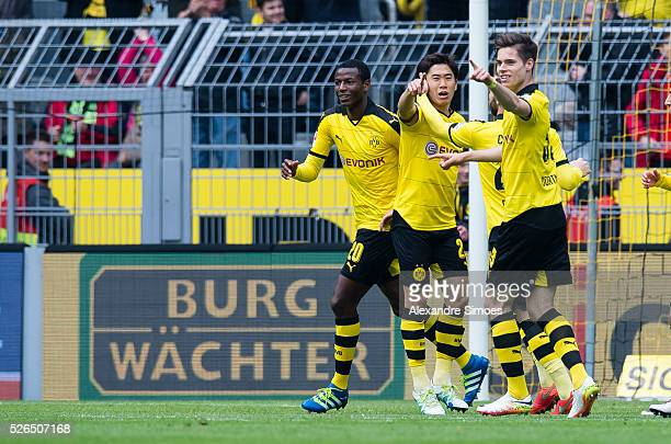 Adrian Ramos of Borussia Dortmund celebrates after scoring the goal to the 20 together with his team mates during the Bundesliga match between...