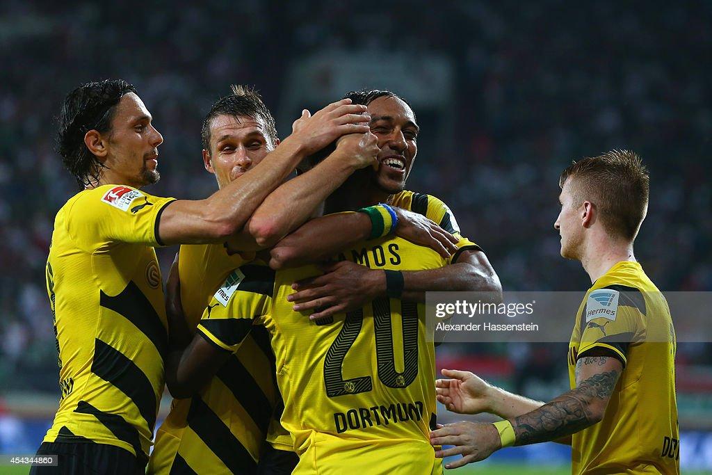 Adrian Ramos of Borussia Dortmund celebrates scoring their third goal with team mates during the Bundesliga match between FC Augsburg and Borussia Dortmund at SGL Arena on August 29, 2014 in Augsburg, Germany.