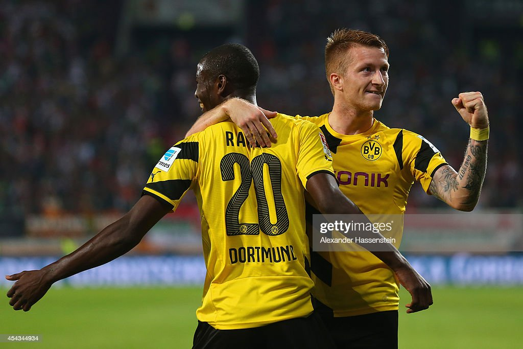 Adrian Ramos of Borussia Dortmund celebrates scoring their third goal with Marco Reus of Borussia Dortmund during the Bundesliga match between FC Augsburg and Borussia Dortmund at SGL Arena on August 29, 2014 in Augsburg, Germany.