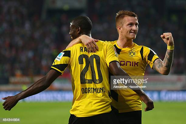 Adrian Ramos of Borussia Dortmund celebrates scoring their third goal with Marco Reus of Borussia Dortmund during the Bundesliga match between FC...