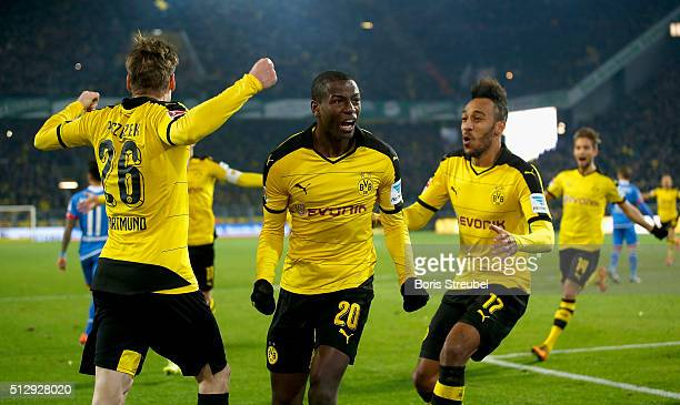 Adrian Ramos of Borussia Dortmund celebrates with Lukasz Piszczek and PierreEmerick Aubameyang after scoring his team's second goal during the...