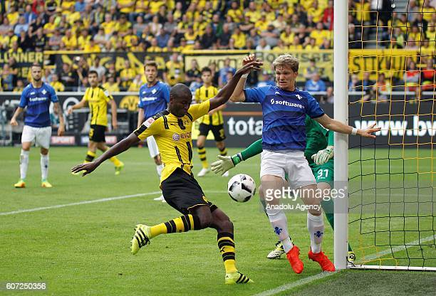 Adrian Ramos of Borussia Dortmund in action against Florian Jungwirth of SV Darmstadt 98 during Bundesliga soccer match between Borussia Dortmund and...