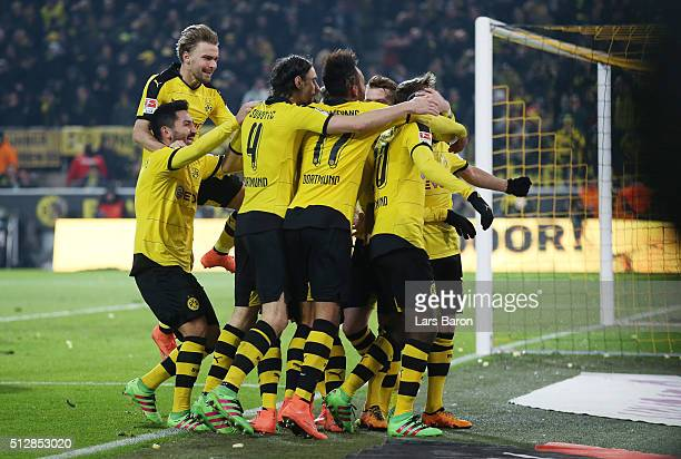 Adrian Ramos of Borussia Dortmund is mobbed by team mates after scoring his team's second goal with a header during the Bundesliga match between...