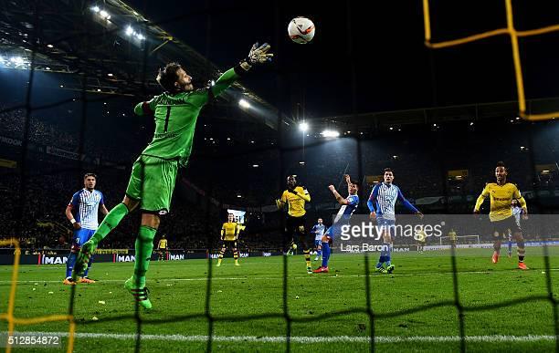 Adrian Ramos of Dortmund heads his teams second goal against goalkeeper Oliver Baumann of Hoffenheim during the Bundesliga macth between Borussia...