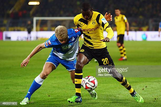 Adrian Ramos of Dortmund is challenged by Andreas Beck of Hoffenheim during the Bundesliga match between Borussia Dortmund and 1899 Hoffenheim at...