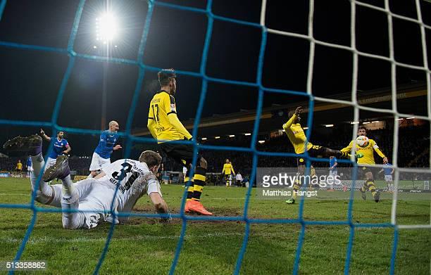 Adrian Ramos of Dortmund scores his team's first goal past goalkeeper Christian Mathenia of Darmstadt during the Bundesliga match between SV...