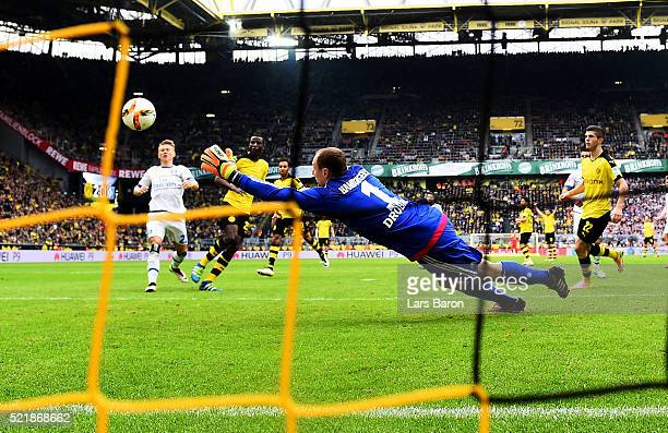 Adrian Ramos of Dortmund scores his teams third goal against goal keeper Jaroslav Drobny of Hamburgduring the Bundesliga match between Borussia...