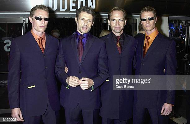 Adrian Rayment Lambert Wilson Hugo Weaving and Neil Rayment attend 'The Matrix Reloaded' premiere at the Odeon Leicester Square on May 21 2003 in...