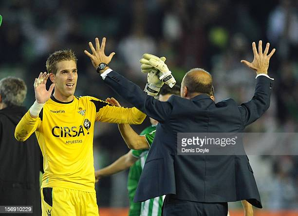 Adrian San Miguel of Real Betis Balompie celebrates with his head coach Pepe Mel after Betis beat Real 10 during the La Liga match between Real Betis...
