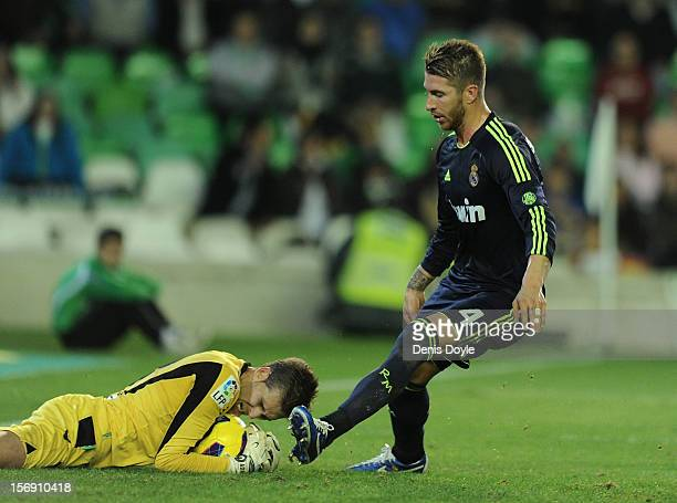Adrian San Miguel of Real Betis Balompie saves the ball in front of Sergio Ramos of Real Madrid CF gets his shot at goal blocked by during the La...