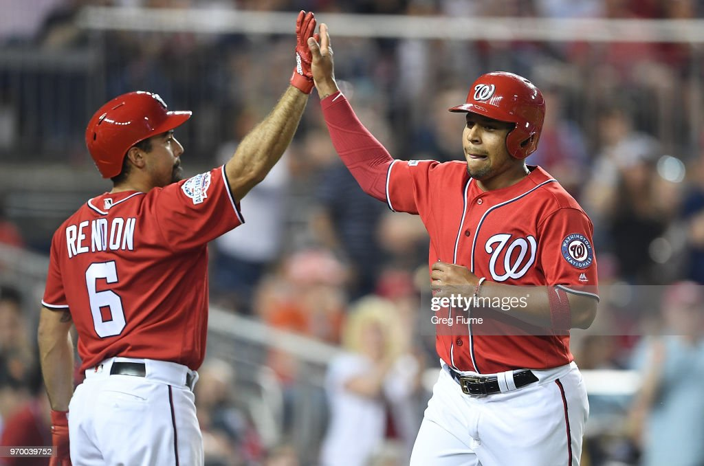 Adrian Sanchez #5 of the Washington Nationals celebrates with Anthony Rendon #6 after scoring in the fifth inning against the San Francisco Giants at Nationals Park on June 8, 2018 in Washington, DC.
