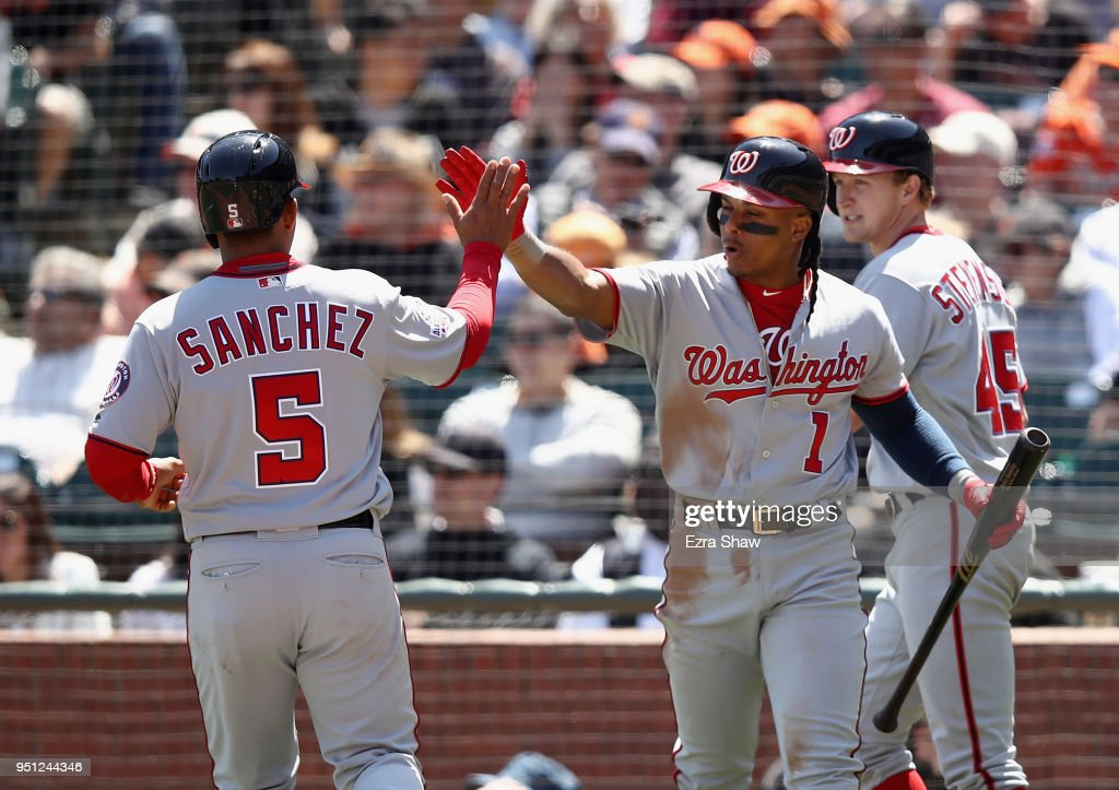 Adrian Sanchez #5 of the Washington Nationals is congratulated by Wilmer Difo #1 after he scored in the fifth inning against the San Francisco Giants at AT&T Park on April 25, 2018 in San Francisco, California.