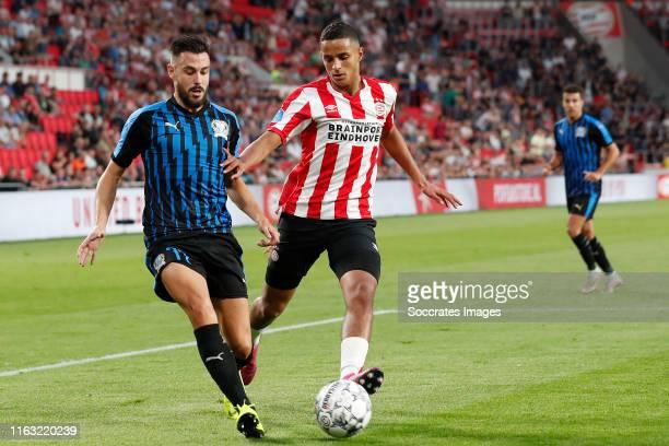 Adrian Sardinero of Apollon Limassol Mohammed Ihattaren of PSV during the UEFA Europa League match between PSV v Apollon Limassol at the Philips...
