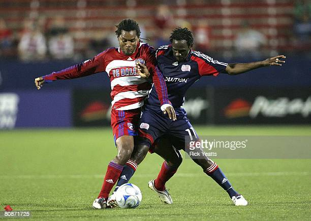 Adrian Serioux of FC Dallas fight for control oif the ball from Kheli Dube of the New England Revolution on April 24, 2008 at Pizza Hut Park in...