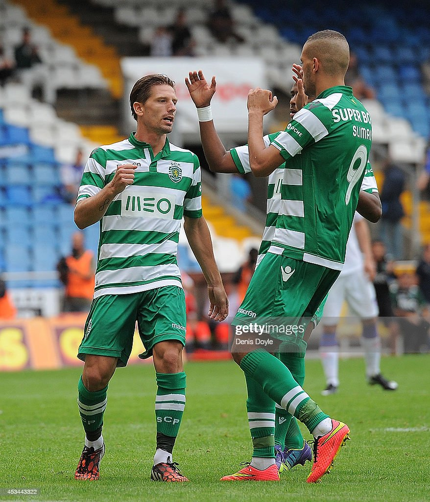 Adrian Silva (L) of Sporting Clube de Portugal celebrates after scoring his team's opening goal during the Teresa Herrera Trophy match between Sporting Clube de Portugal and Club Nacional de Football at estadio Municipal de Riazor on August 10, 2014 in A Coruna, Spain.