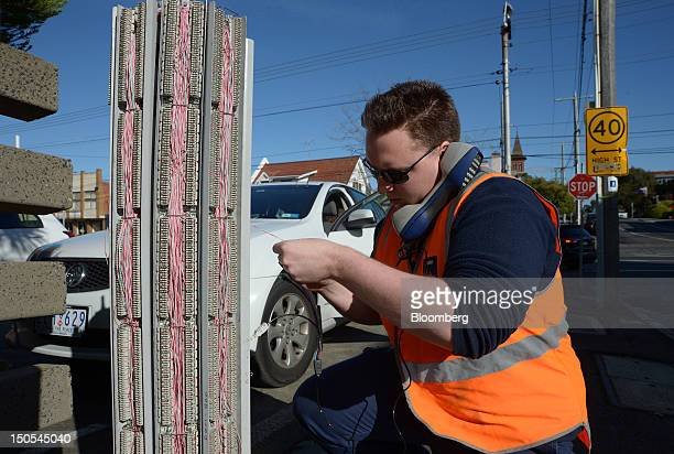 Adrian Smith a field technician for Telstra Corp conducts maintenance work on one of the company's communication pillars in the suburb of Northcote...