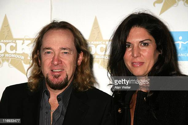 Adrian Smith of Iron Maiden and guest during 2006 Classic Roll and Roll Honour Arrivals at Langham Hotel in London Great Britain