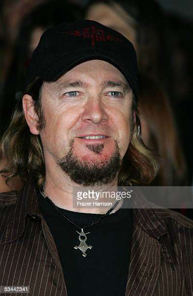 Adrian Smith of Iron Maiden poses for a photograph as he is inducted into Hollywood's Rock Walk at the Guitar Center on August 19 2005 in Hollywood...