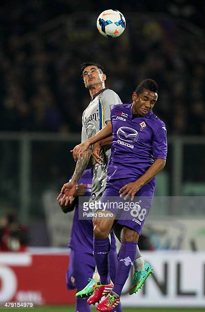 Adrian Stoian of AC Chievo Verona competes for the ball with Anderson of ACF Fiorentina during the Serie A match between ACF Fiorentina and AC Chievo...