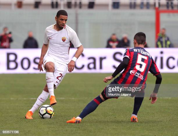 Adrian Stoian of Crotone competes for the ball with Bruno Peres of Roma during the serie A match between FC Crotone and AS Roma at Stadio Comunale...