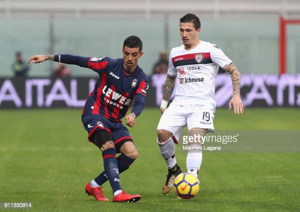 Adrian Stoian of Crotone competes for the ball with Fabio Pisacane of Cagliari during the serie A match between FC Crotone and Cagliari Calcio at...