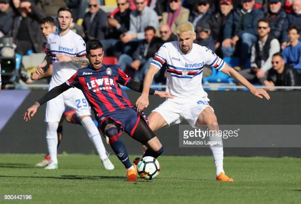 Adrian Stoian of Crotone competes for the ball with Gaston Ramirez of Sampdoria during the serie A match between FC Crotone and UC Sampdoria at...