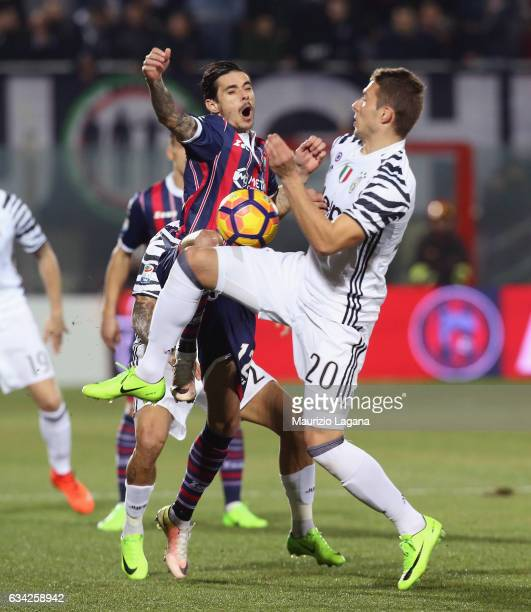 Adrian Stoian of Crotone competes for the ball with Marco Pjaca of Juvents during the Serie A match between FC Crotone and Juventus FC at Stadio...