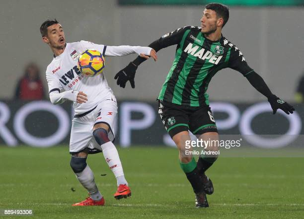 Adrian Stoian of FC Crotone competes for the ball with Luca Mazzitelli of US Sassuolo Calcio during the Serie A match between US Sassuolo and FC...