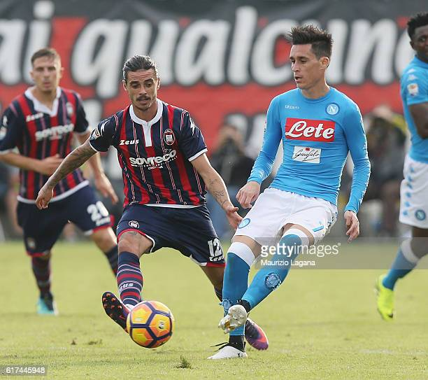 Adrian Stojan of Crotone competes for the ball with Josè Maria Callejon of Napoli during the Serie A match between FC Crotone and SSC Napoli at...