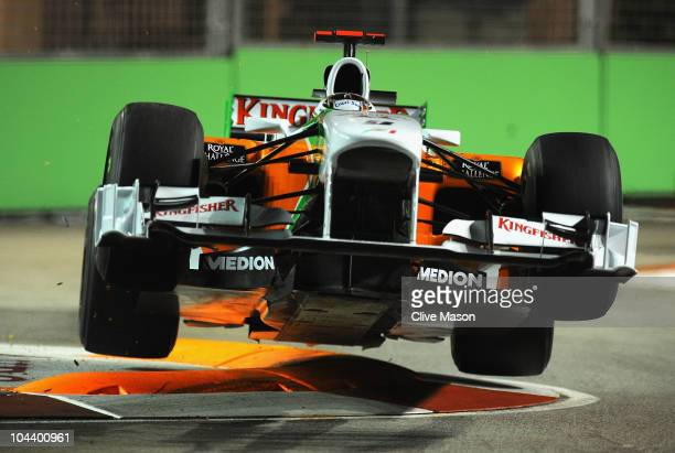 Adrian Sutil of Germany and Force India goes airborne as he hits a curb during practice for the Singapore Formula One Grand Prix at the Marina Bay...