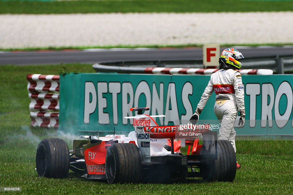 Adrian Sutil of Germany and Force India retires from the Malaysian Formula One Grand Prix at the Sepang Circuit on March 23, 2008 in Kuala Lumpur, Malaysia.