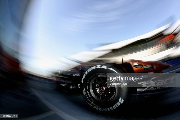 Adrian Sutil of Germany and Spyker F1 drives in the pit lane during practice for the Italian Formula One Grand Prix at the Autodromo Nazionale di...