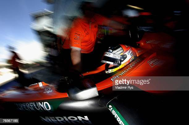 Adrian Sutil of Germany and Spyker F1 is pushed with his car back in the garage during practice for the Italian Formula One Grand Prix at the...
