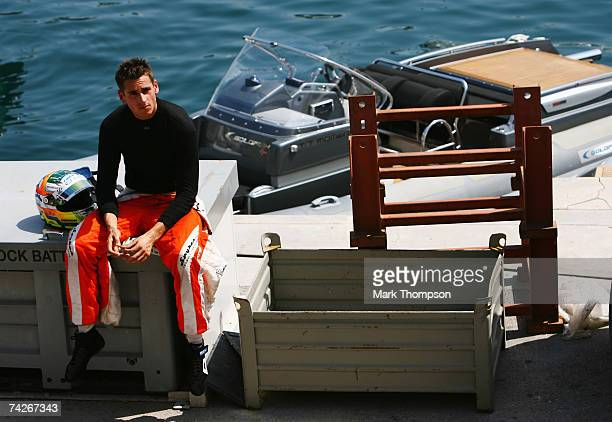 Adrian Sutil of Germany and Spyker F1 sits by the harbour after crashing out during practice for the Monaco Formula One Grand Prix at the Monte Carlo...