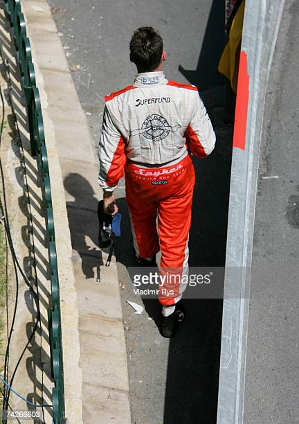 Adrian Sutil of Germany and Spyker F1 walks along the track after crashing during the practice session for the Monaco Formula One Grand Prix at the...