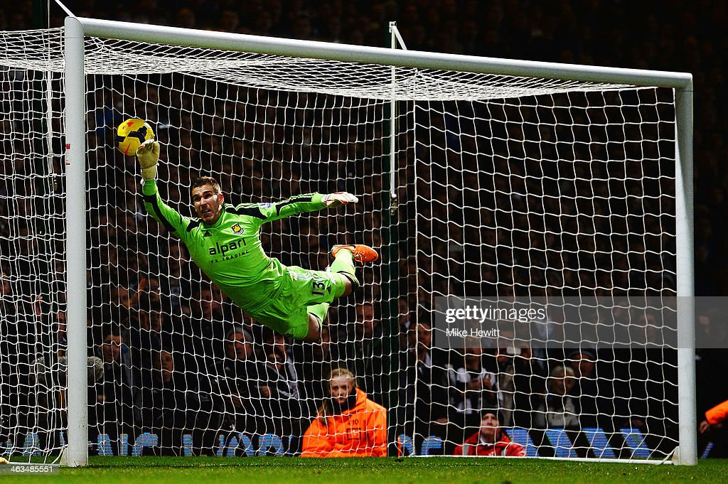 Adrian the West Ham United goalkeeper fails to stop the freekick of Yohan Cabaye (unseen) of Newcastle United during the Barclays Premier League match between West Ham United and Newcastle United at the Boleyn Ground on January 18, 2014 in London, England.