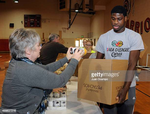 Adrian Thomas of the Bakersfield Jam helps fill a Thanksgiving dinner box during the Bakersfield Jam Thanksgiving Box Give Away Event on November 26...