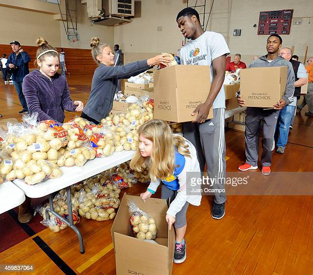 Adrian Thomas of the Bakersfield Jam helps fill Thanksgiving food boxes during the Bakersfield Jam Thanksgiving Box Give Away Event on November 26...