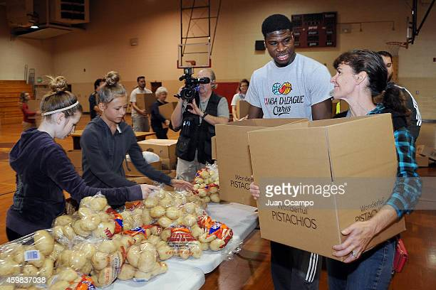 Adrian Thomas of the Bakersfield Jam talks with a volunteer as they help fill Thanksgiving food boxes during the Bakersfield Jam Thanksgiving Box...