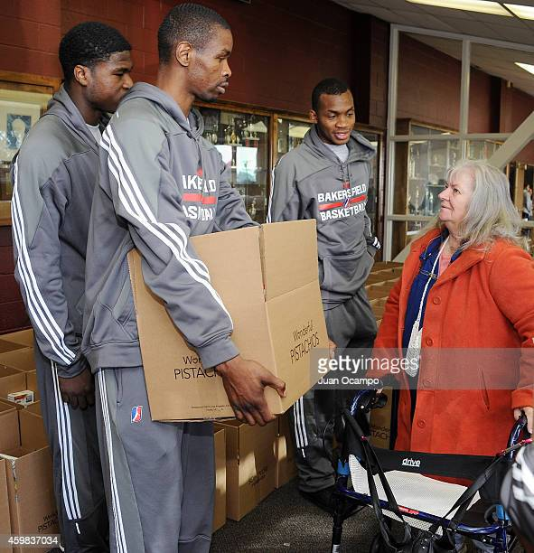 Adrian Thomas Renaldo Major and Elijah Millsap of the Bakersfield Jam talk with a community recipient during the Bakersfield Jam Thanksgiving Box...