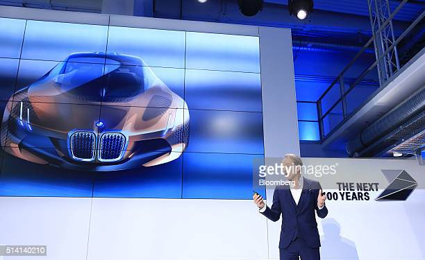 Adrian van Hooydonk chief designer at Bayerische Motoren Werke AG speaks while a BMW Vision Next 100 concept automobile is displayed on a screen...